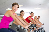 Spin class working out and smiling at camera — Stock Photo