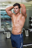 Muscular man looking away in gym — Stock Photo