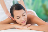 Brunette enjoying shoulder massage — Stock Photo