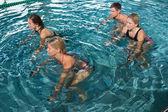 Fitness class using underwater exercise bikes — Stock Photo