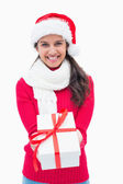Beautiful festive woman offering gift — Stock Photo