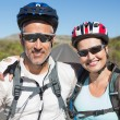 Active couple going for a bike ride in the countryside — Stock Photo #50050065