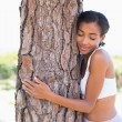 Fit woman hugging a tree — Stock Photo #50050185