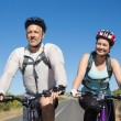 Active couple going for a bike ride in the countryside — Stock Photo #50050203
