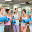 Smiling women in fitness studio before yoga class — Stock Photo #50050227