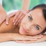 Brunette enjoying back massage — Stock Photo #50050987