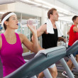 Row of people working out on treadmills — Stock Photo #50051243