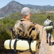 Hiking couple walking on mountain trail — Stock Photo #50051571