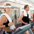 Row of people working out on treadmills — Stock Photo #50051965