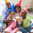 Family celebrating a birthday together in the garden — Stock Photo #50052255