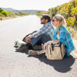 Couple sitting on road waiting for lift — Stock Photo #50052285
