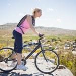 Cyclist on rocky terrain — Stock Photo #50052933
