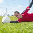 Goalkeeper in red making a save — Stock Photo #50053495
