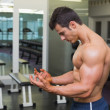 Shirtless muscular man posing in gym — Foto Stock #50053605