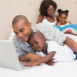 Happy family spending time together on bed — Stock Photo #50054275