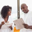 Happy couple having breakfast together in bathrobes — Stock Photo #50054495