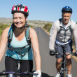 Active couple going for a bike ride in the countryside — Stock Photo #50055241