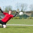 Goalkeeper in red ready to make a save — Stock Photo #50055263