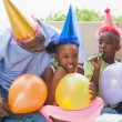 Father and children celebrating a birthday together — Stock Photo #50055561