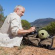 Hiker taking a break on country trail — Stock Photo
