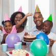 Happy family celebrating a birthday together at table — Stock Photo #50055597
