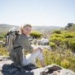 Hiker sitting at the summit — Stock Photo #50055653