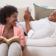 Couple together reading book and using smartphone — Stock Photo #50055803
