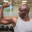 Muscular man flexing muscles in gym — Stock Photo #50056161