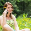 Relaxed woman using mobile phone in field — ストック写真 #50056845