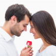 Handsome man offering his girlfriend a rose — Stock Photo