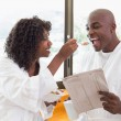 Happy couple having breakfast together in bathrobes — Stock Photo #50057131