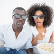 Couple sitting on couch together watching 3d movie — Stock Photo #50057461