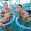 Fitness class doing aqua aerobics — Stock Photo #50057547