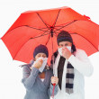Mature couple blowing their noses under umbrella — Stock Photo #50057943