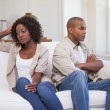 Unhappy couple arguing on the couch — Stock Photo #50058253