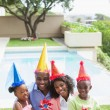 Family celebrating a birthday together in the garden — Stock Photo #50058371