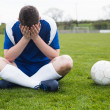 Disappointed football player in blue — Stock Photo #50058507
