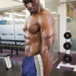 Shirtless muscular man in gym — Foto Stock #50058945