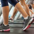 Row of people working out on treadmills — Stock Photo #50058967