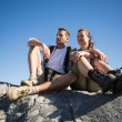 Hiking couple looking out over mountain terrain — Stock Photo #50059253