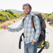 Man hitch hiking on rural road — Stock Photo #50059441