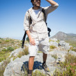 Hiker standing at the summit — Stock Photo #50059523