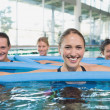Fitness class doing aqua aerobics — Stock Photo #50059529