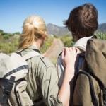 Couple walking on mountain terrain — Stock Photo