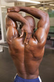 Rear view of a shirtless bodybuilder — ストック写真