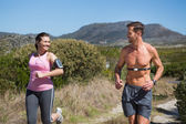 Active couple jogging in the countryside — Foto Stock