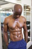 Shirtless muscular man in gym — Stock Photo