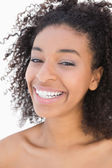 Pretty girl with afro hairstyle smiling at camera — Stock Photo