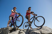 Active couple on a bike ride in the countryside  — Stock Photo
