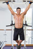 Shirtless male body builder doing pull ups — Foto Stock